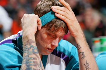 CHARLOTTE, NC - DECEMBER 14:  Chris Andersen #12 of the New Orleans Hornets holds his head after a 94-93 loss to the Charlotte Bobcats on December 14, 2004 at the Charlotte Coliseum in Charlotte, North Carolina.  NOTE TO USER: User expressly acknowledges