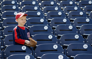 WASHINGTON, DC - APRIL 03:  A young fan watches batting practice before the start of the Atlanta Braves and Washington Nationals game at Nationals Park on April 3, 2011 in Washington, DC.  (Photo by Rob Carr/Getty Images)