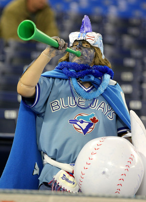 TORONTO - APRIL 6:  A fan of the Toronto Blue Jays cheers during batting practice as the Toronto Blue Jays  prepare to face the Detroit Tigers during their MLB opening day game at the Rogers Centre April 6, 2009 in Toronto, Ontario.(Photo By Dave Sandford