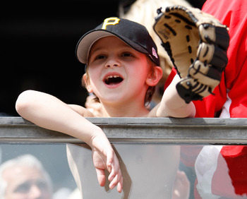 PITTSBURGH - APRIL 07:  A young fan looks to get a ball during the Opening Day game between the Pittsburgh Pirates and the Colorado Rockies on April 7, 2011 at PNC Park in Pittsburgh, Pennsylvania.  (Photo by Jared Wickerham/Getty Images)