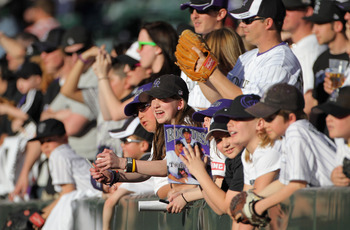 DENVER, CO - APRIL 02:  Fans look to get autographs from players as the Colorado Rockies host the Arizona Diamondbacks at Coors Field on April 2, 2011 in Denver, Colorado.  (Photo by Doug Pensinger/Getty Images)