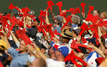 ATLANTA - OCTOBER 6:  Fans of the Atlanta Braves do the Tomahawk Chop during their game against the Houston Astros in game one of the National League Divisional Series on October 6, 2004 at Turner Field in Atlanta, Georgia.  (Photo by Streeter Lecka/Getty