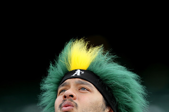 OAKLAND, CA - APRIL 01:  A fan looks on before the start of the Opening Day game with the Oakland Athletics and the Seattle Mariners at the Oakland-Alameda County Coliseum on April 1, 2011 in Oakland, California  (Photo by Justin Sullivan/Getty Images)