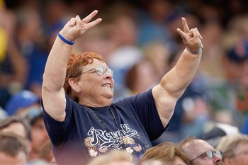 KANSAS CITY - JUNE 12:  A fan of the Kansas City Royals cheers in the stands during the game against the Cincinnati Reds on June 12, 2009 at Kauffman Stadium in Kansas City, Missouri. (Photo by Jamie Squire/Getty Images)