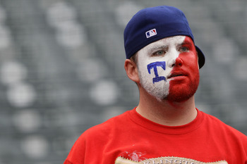 ARLINGTON, TX - OCTOBER 22:  A fan of the Texas Rangers looks on prior to the Rangers playing the New York Yankees in Game Six of the ALCS during the 2010 MLB Playoffs at Rangers Ballpark in Arlington on October 22, 2010 in Arlington, Texas.  (Photo by El