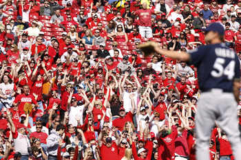 CINCINNATI, OH - APRIL 3: Cincinnati Reds fans cheer late in the game against the Milwaukee Brewers at Great American Ball Park on April 3, 2011 in Cincinnati, Ohio. The Reds won 12-3 to finish off a three-game sweep. (Photo by Joe Robbins/Getty Images)