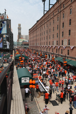 BALTIMORE, MD - APRIL 04:  Fans enter Oriole Park at Camden Yards during opening day between the Baltimore Orioles and the Detroit Tigers on April 4, 2011 in Baltimore, Maryland.  (Photo by Rob Carr/Getty Images)
