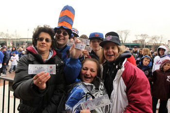 NEW YORK, NY - APRIL 08:  Fans of the New York Mets show off their tickets as they make their way into the stdium to watch them play against the Washington Nationals during the Mets' Home Opener at Citi Field on April 8, 2011 in the Flushing neighborhood