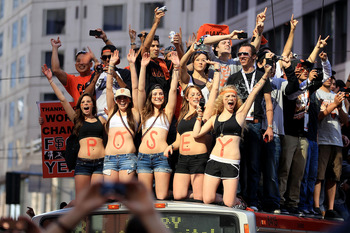 SAN FRANCISCO - NOVEMBER 03:  Buster Posey fans wave for him during the San Francisco Giants victory parade on November 3, 2010 in San Francisco, California.  (Photo by Ezra Shaw/Getty Images)