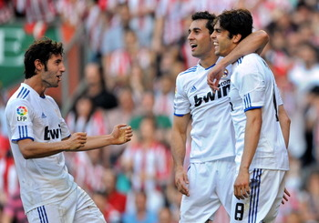 BILBAO, SPAIN - APRIL 09:  Kaka (R) of Real Madrid celebrates with Esteban Granero (L) and  Alvaro Arbeloa after scoring Real's second goal during the La Liga match between Athletic Bilbao and Real Madrid at San Mames Stadium on April 9, 2011 in Bilbao, S