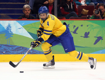VANCOUVER, BC - FEBRUARY 22:  Jenni Asserholt of Sweden moves the puck against the United States during the ice hockey women's semifinal game game between on day 11 of the Vancouver 2010 Winter Olympics at Canada Hockey Place on February 22, 2010 in Vanco