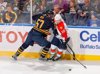 BUFFALO, NY - MARCH 25: David Booth #10 of the Florida Panthers looks to make a play as he is checked by Tyler Myers #57 of the Buffalo Sabres at HSBC Arena on March 25, 2011 in Buffalo, New York.  (Photo by Rick Stewart/Getty Images)