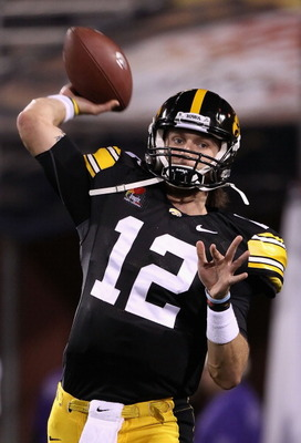 TEMPE, AZ - DECEMBER 28:  Quarterback Ricky Stanzi #12 of the Iowa Hawkeyes warms up before the Insight Bowl against the Missouri Tigers at Sun Devil Stadium on December 28, 2010 in Tempe, Arizona.  (Photo by Christian Petersen/Getty Images)