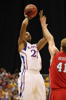 SAN ANTONIO, TX - MARCH 25:  Markieff Morris #21 of the Kansas Jayhawks puts up a shot against the Richmond Spiders during the southwest regional of the 2011 NCAA men's basketball tournament at the Alamodome on March 25, 2011 in San Antonio, Texas.  (Phot