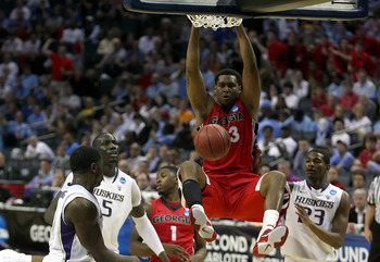 CHARLOTTE, NC - MARCH 18:  Trey Thompkins #33 of the Georgia Bulldogs dunks the ball while taking on the Washington Huskies during the second round of the 2011 NCAA men's basketball tournament at Time Warner Cable Arena on March 18, 2011 in Charlotte, Nor
