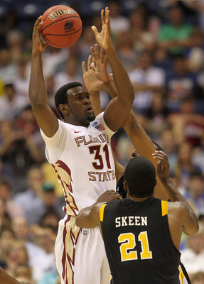 SAN ANTONIO, TX - MARCH 25:  Chris Singleton #31 of the Florida State Seminoles looks to pass the ball against Jamie Skeen #21 of the Virginia Commonwealth Rams during the southwest regional of the 2011 NCAA men's basketball tournament at the Alamodome on