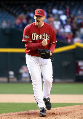 PHOENIX, AZ - APRIL 10:  Relief pitcher J.J. Putz #40 of the Arizona Diamondbacks celebrates after defeating the Cincinnati Reds in the Major League Baseball game at Chase Field on April 10, 2011 in Phoenix, Arizona. The Diamondbacks defeated the Reds 10-