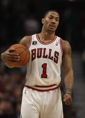 CHICAGO, IL - APRIL 07: Derrick Rose #1 of the Chicago Bulls holds the ball during a break in the action against the Boston Celtics at United Center on April 7, 2011 in Chicago, Illinois. The Bulls defeated the Celtics 97-81. NOTE TO USER: User expressly