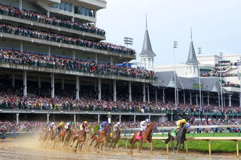LOUISVILLE, KY - MAY 01:  Jockey Martin Garcia atop Conveyance leads the field around turn one during the 136th running of the Kentucky Derby on May 1, 2010 in Louisville, Kentucky.  (Photo by Matthew Stockman/Getty Images)