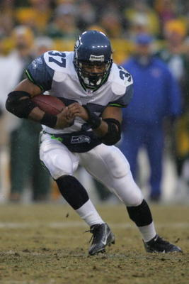 GREEN BAY, WI - JANUARY 12:  Running back Shaun Alexander #37 of the Seattle Seahawks runs the ball against the Green Bay Packers in the NFC divisional playoff game on January 12, 2008 at Lambeau Field in Green Bay, Wisconsin. The Packers defeated the Sea