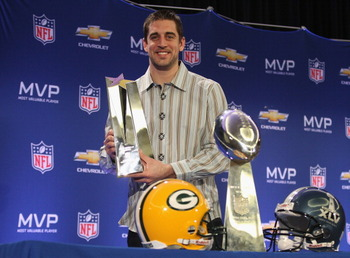 DALLAS, TX - FEBRUARY 07:  Green Bay Packers quarterback Aaron Rodgers poses with the MVP trophy after speaking to the media during a press conference at Super Bowl XLV Media Center on February 7, 2011 in Dallas, Texas.  (Photo by Streeter Lecka/Getty Ima