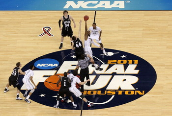 HOUSTON, TX - APRIL 04:  Andrew Smith #44 of the Butler Bulldogs tips the ball off against Alex Oriakhi #34 of the Connecticut Huskies to start the National Championship Game of the 2011 NCAA Division I Men's Basketball Tournament at Reliant Stadium on Ap