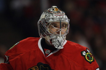 CHICAGO, IL - APRIL 10: Corey Crawford #50 of the Chicago Blackhawks rests during a break in the action against the Detroit Red Wings at the United Center on April 10, 2011 in Chicago, Illinois. The Red Wings defeated the Blackhawks 4-3. (Photo by Jonatha