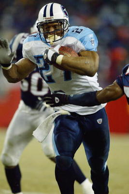 FOXBORO, MA - JANUARY 10:  Running back Eddie George #27 of the Tennessee Titans carries the football against the New England Patriots in the AFC divisional playoffs on January 10, 2004 at Gillette Stadium in Foxboro, Massachusetts. The Patriots won 17-14