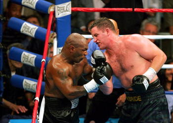 WASHINGTON - JUNE 11:  Kevin McBride (R) of Ireland hits Mike Tyson against the ropes in the 6th round during their heavyweight bout on June 11, 2005 at the MCI Center in Washington, DC.  (Photo By Jamie Squire/Getty Images)