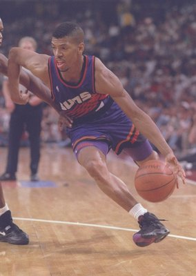 13 Jun 1993: Guard Kevin Johnson of the Phoenix Suns moves the ball during a game against the Chicago Bulls at the United Center in Chicago, Illinois. The Suns won the game, 129-121.