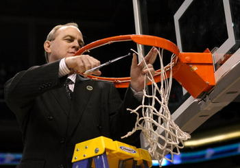 PHOENIX - MARCH 29:  Head coach Ben Howland of the UCLA Bruins cuts down the net following his team victory over the Xavier Musketeers in the West Regional Final on March 29, 2008 at the U.S. Airways Center in Phoenix, Arizona.  The Bruins won the game wi