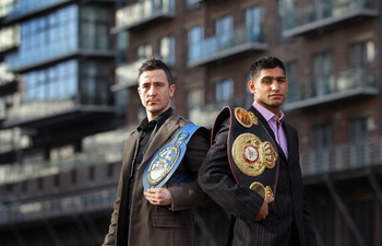 MANCHESTER, ENGLAND - FEBRUARY 08:  Amir Khan poses with his WBA light-welterweight belt as he stands alongside his next challenger for the title Paul McCloskey at a photocall at the Lowery Hotel on February 8, 2011 in Manchester, England.  (Photo by Alex