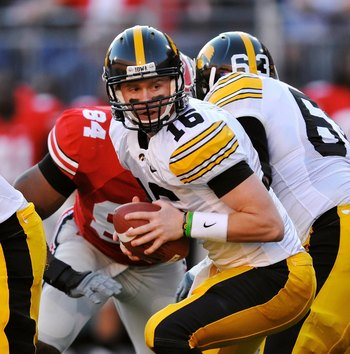 COLUMBUS, OH - NOVEMBER 14:  Quarterback James Vandenberg #16 of the Iowa Hawkeyes gets set to hand off the ball against the Ohio State Buckeyes at Ohio Stadium on November 14, 2009 in Columbus, Ohio.  (Photo by Jamie Sabau/Getty Images)