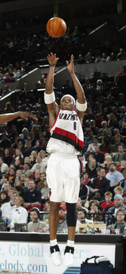 PORTLAND - DECEMBER 17:  Bonzi Wells #6 of the Portland Trail Blazers shoots a jumpshot during the game against the New Orleans Hornets at Rose Garden on December 17, 2002 in Portland, Oregon.  The Trail Blazers won 102-93.  NOTE TO USER: User expressly a
