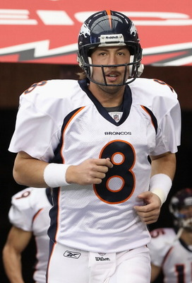 GLENDALE, AZ - DECEMBER 12:  Quarterback Kyle Orton #8 of the Denver Broncos runs out onto the field before the NFL game against the Arizona Cardinals at the University of Phoenix Stadium on December 12, 2010 in Glendale, Arizona.  The Cardinals defeated