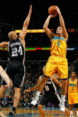 NEW ORLEANS, LA - JANUARY 22:  Marco Belinelli #8 of the New Orleans Hornets shoots the ball over Richard Jefferson #24  of the San Antonio Spurs at the New Orleans Arena on January 22, 2011 in New Orleans, Louisiana.  NOTE TO USER: User expressly acknowl