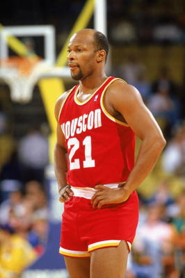 INGLEWOOD - 1987:  World B. Free #21 of the Houston Rockets waits during a game in the1987-88 season against the Los Angeles Lakers at the Forum in Inglewood, California. NOTE TO USER: User expressly acknowledges and agrees that, by downloading and/or usi