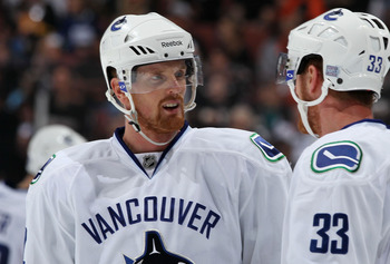 ANAHEIM, CA - OCTOBER 13:  (L-R) Brothers Daniel Sedin #22 and Henrik Sedin #33 of the Vancouver Canucks speak during their game against the Anaheim Ducks at Honda Center on October 13, 2010 in Anaheim, California.  (Photo by Jeff Gross/Getty Images)