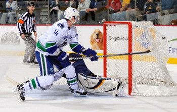 NASHVILLE, TN - MARCH 29:  Alexandre Burrows #14 of the Vancouver Canucks scores the game winning goal on a breakaway against Pekka Rinne #35 of the Nashville Predators on March 29, 2011 at the Bridgestone Arena in Nashville, Tennessee.  (Photo by Frederi