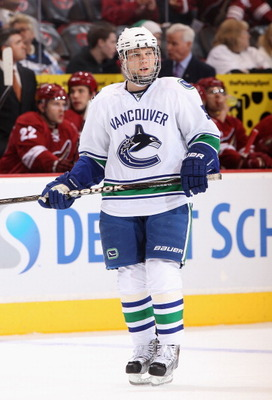 GLENDALE, AZ - FEBRUARY 02:  Cody Hodgson #39 of the Vancouver Canucks skates up to a face off against the Phoenix Coyotes during the NHL game at Jobing.com Arena on February 2, 2011 in Glendale, Arizona. The Canucks defeated the Coyotes 6-0.  (Photo by C