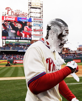 PHILADELPHIA, PA - APRIL 01:  John Mayberry Jr. #15 of the Philadelphia Phillies smiles after getting hit with a cream pie after driving in the game winning run to defeat the Houston Astros 5-4 on opening day at Citizens Bank Park on April 1, 2011 in Phil