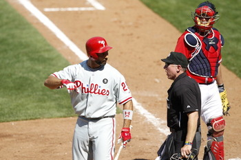 ATLANTA, GA - APRIL 10: Raul Ibanez #29 of the Philadelphia Phillies argues with home plate umpire Lance Barksdale after being called out on strikes against the Atlanta Braves at Turner Field on April 10, 2011 in Atlanta, Georgia. The Phillies won 3-0. (P