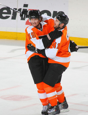 BUFFALO, NY - APRIL 08: Scott Hartnell #19 and Andrej Meszaros #41 of the Philadelphia Flyers celebrate Hartnell's goal in the first period against the Buffalo Sabres  at HSBC Arena on April 8, 2011 in Buffalo, New York.  (Photo by Rick Stewart/Getty Imag