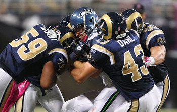 ST. LOUIS - OCTOBER 3: Anthony McCoy #85 of the Seattle Seahawks is stopped by Larry Grant #59, Craig Dahl #43 and James Laurinaitis #55 all of the St. Louis Rams at the Edward Jones Dome on October 3, 2010 in St. Louis, Missouri.  The Rams beat the Seaha