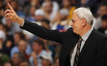DENVER - NOVEMBER 11:  Head coach Phil Jackson of the Los Angeles Lakers directs his team against the Denver Nuggets at the Pepsi Center on November 11, 2010 in Denver, Colorado. The Nuggets defeated the Lakers 118-112.  NOTE TO USER: User expressly ackno