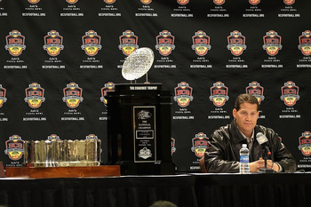 SCOTTSDALE, AZ - JANUARY 11:  Head coach Gene Chizik of the Auburn Tigers sits with the (L-R) Associated Press, Football Writers of America, MacArthur Bowl and the Coaches trophys during a press conference for the Tostitos BCS National Championship Game a