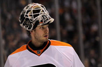 LOS ANGELES, CA - DECEMBER 30:  Goaltender Michael Leighton #49 of the Philadelphia Flyers looks on during a breeak in the game with the Los Angeles Kings at Staples Center on December 30, 2010 in Los Angeles, California.  (Photo by Stephen Dunn/Getty Ima