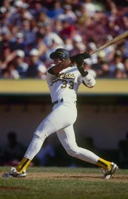 OAKLAND, CA - AUGUST 15:  Jose Canseco of the Oakland Athletics bats during the game against the California Angels at Oakland-Alameda County Coliseum on August 15, 1992 in Oakland, California. (Photo by Otto Greule Jr/Getty Images)