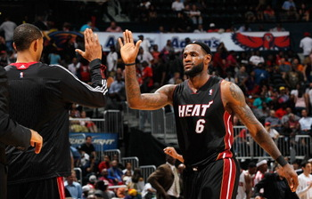 ATLANTA, GA - APRIL 11:  LeBron James #6 of the Miami Heat celebrates after a basket against the Atlanta Hawks at Philips Arena on April 11, 2011 in Atlanta, Georgia.  NOTE TO USER: User expressly acknowledges and agrees that, by downloading and/or using