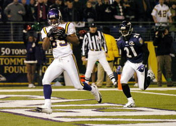 Former Gator Travis Taylor scores a touchdown for Minnesota against the team that drafted him, Baltimore.